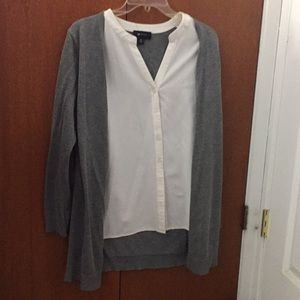 A business blouse with grey sweater attached